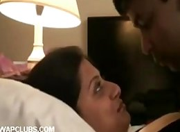 Indian couple kiss his in hotel